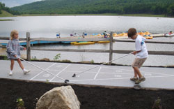 Kids Playing Shuffleboard at the Lake
